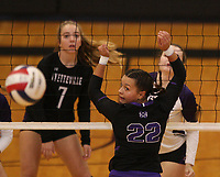 Arkansas Democrat-Gazette/STATON BREIDENTHAL --10/29/19-- Mount St. Mary Academy's Annison Yates (right) and Fayetteville's Gracyn Spresser watch to see where the ball lands Tuesday during their game in the 6A state Volleyball Tournament in Cabot. See more photos at arkansasonline.com/1030volleyball6A/.