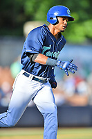 Asheville Tourists Daniel Montano (24) runs to first base during a game against the Columbia Fireflies at McCormick Field on June 22, 2019 in Asheville, North Carolina. The Tourists defeated the Fireflies 6-5. (Tony Farlow/Four Seam Images)