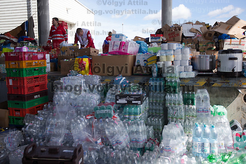 Volunteers arrange donations to be distributed to illegal migrants traveling to Germany at an aid distribution point at Hegyeshalom border crossing (about 180 km West of capital city Budapest), Hungary on September 06, 2015. ATTILA VOLGYI