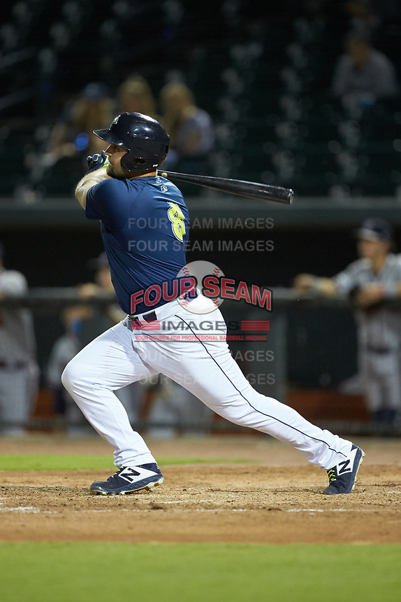 Chase Chambers (8) of the Columbia Fireflies follows through on his swing against the Rome Braves at Segra Park on May 13, 2019 in Columbia, South Carolina. The Fireflies defeated the Braves 6-1 in game two of a doubleheader. (Brian Westerholt/Four Seam Images)
