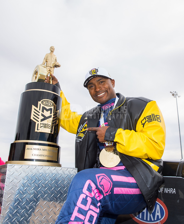 Oct 30, 2016; Las Vegas, NV, USA; NHRA top fuel driver Antron Brown celebrates after clinching the 2016 NHRA top fuel world championship during the Toyota Nationals at The Strip at Las Vegas Motor Speedway. Mandatory Credit: Mark J. Rebilas-USA TODAY Sports