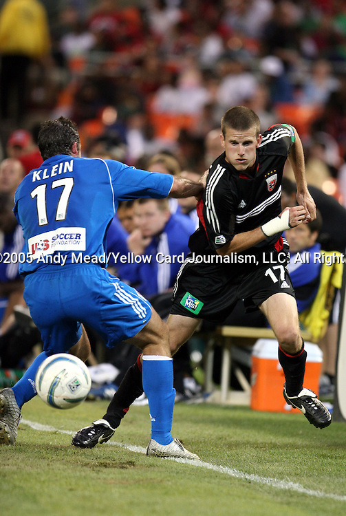21 May 2005: Joshua Gros (right) tries to move past Chris Klein (left). DC United defeated the Kansas City Wizards 3-2 at RFK Stadium in Washington, DC in a regular season Major League Soccer game. . .