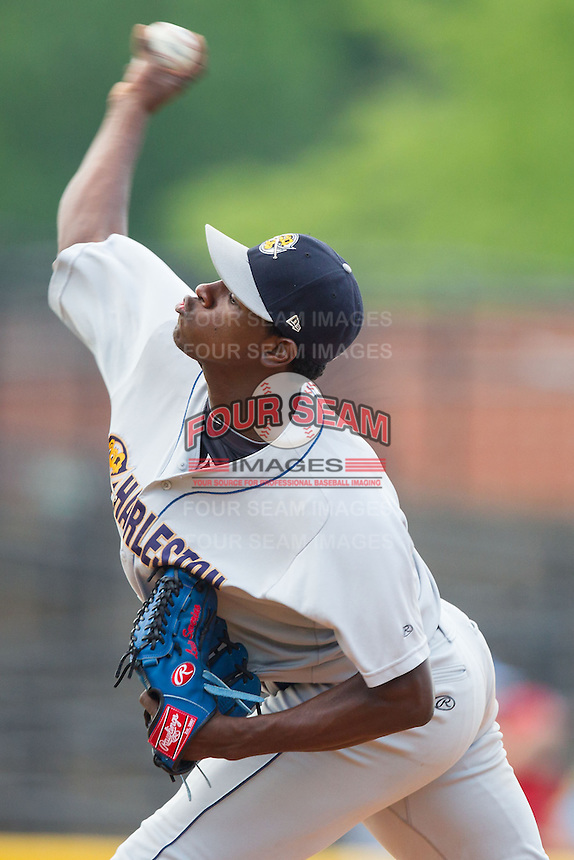Charleston RiverDogs starting pitcher Luis Severino (6) delivers a pitch to the plate against the Hickory Crawdads at L.P. Frans Stadium on May 25, 2014 in Hickory, North Carolina.  The RiverDogs defeated the Crawdads 17-10.  (Brian Westerholt/Four Seam Images)
