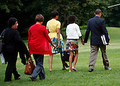 Washington, DC - July 5, 2009 -- United States President Barack Obama (R), his wife Michelle (3R), daughter Malia (2R) and Michelle's mother Marian Shields Robinson ((2L) leave the White House, en route to Moscow Russia, Washington, DC, July 5, 2009. Younger daughter Sasha is also traveling with them..Credit: Aude Guerrucci - Pool via CNP
