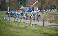 3 Days of De Panne.stage 1: Middelkerke - Zottegem..Lotto-Belisol leading a stretched peloton