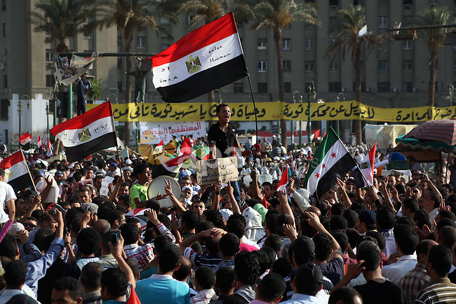 Egyptian protesters shout slogans against former President Hosni Mubarak and his aides during the third day of protests after the announcement of the verdict in their trial, in Tahrir square, Cairo, Egypt, 04 June 2012. Opposition groups have called for mass protests on 05 June against the verdict in the trial of Mubarak and security aides and against the candidacy of Ahmed Shafik, Mubarak's last premier, in the presidential election runoff. Photo by Ashraf Amra