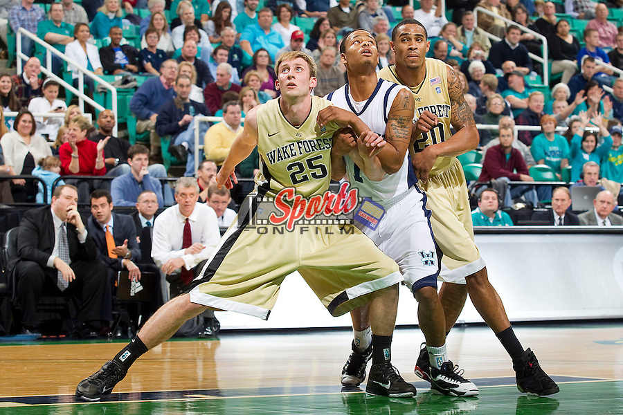 Nikita Mescheriakov #25 and Ari Stewart #20 of the Wake Forest Demon Deacons box out Donte Morales #1 at the Greensboro Coliseum on December 12, 2010 in Greensboro, North Carolina.  The Seahawks defeated the Demon Deacons 81-69. Photo by Brian Westerholt / Sports On Film