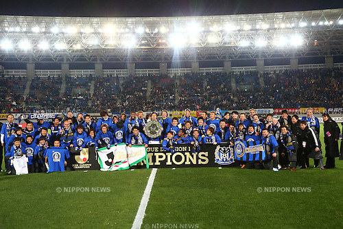 Gamba Osaka team group,<br /> DECEMBER 6, 2014 - Football / Soccer :<br /> Gamba Osaka players celebrate their league title with the trophy after the 2014 J.League Division 1 match between Tokushima Vortis 0-0 Gamba Osaka at Naruto Otsuka Sports Park Pocarisweat Stadium in Tokushima, Japan. (Photo by Kenzaburo Matsuoka/AFLO)