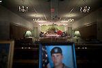August 25, 2007. Kinston, NC.. A viewing of the coffin of Spc. Steven R. Jewell was held at Howard and Carter Funeral Home i Kinston, NC. Spc. Steven R. Jewell was killed in a helicopter crash near the Iraqi city of Fallujah on August 14, 2007.. A photograph of Spc. Jewell sits in the funeral home lobby. His coffin is in the background.. .