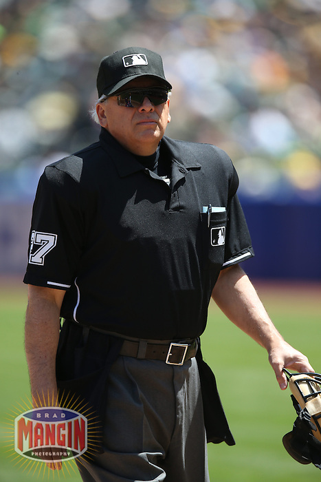 OAKLAND, CA - APRIL 23:  Umpire Larry Vanover works behind the plate during the game between the Texas Rangers and Oakland Athletics at O.co Coliseum on Wednesday, April 23, 2014 in Oakland, California. Photo by Brad Mangin