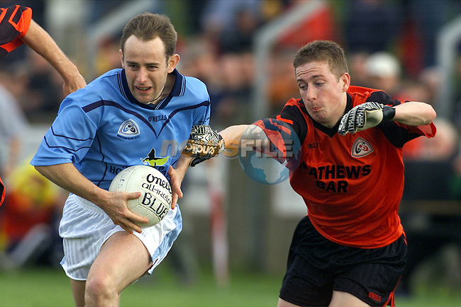 Newtown Blues' Padraig Stone and Mattock Rangers' Ernie Roache in action in the Louth Senior Football Championship Final..Picture: Paul Mohan/Newsfile