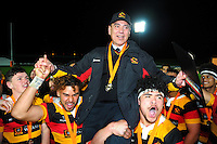 Waikato players lift up coach Alf Daniels after winning the Graham Mourie Cup final between Waikato and Auckland in the Jack Hobbs Memorial Under-19 Rugby Tournament at Owen Delaney Park in Taupo, New Zealand on Wednesday, 21 September 2016. Photo: Dave Lintott / lintottphoto.co.nz