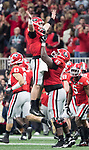 Georgia Bulldogs offensive tackle Kendall Baker (65) lifts Georgia Bulldogs quarterback Jake Fromm (11) after Fromm threw a touchdown pass against thew Alabama Crimson Tide in the third quarter of the NCAA College Football Playoff National Championship at Mercedes-Benz Stadium on January 8, 2018 in Atlanta. Alabama defeated Georgia 26-23.  Photo by Mark Wallheiser/UPI