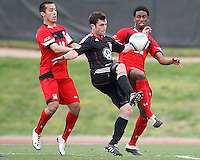 Stephen King (7) of D.C. United between Alex Lee (18) and London Woodbury (22)  during a scrimmage against the University of Maryland at Ludwig Field, University of Maryland, College Park, on April  10 2011. D.C. United won 1-0.