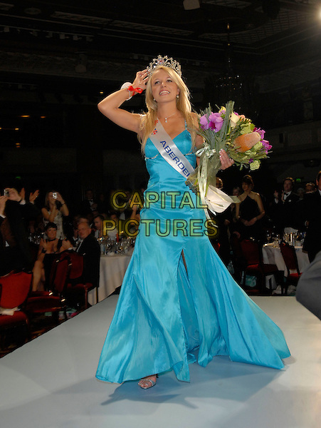 RACHEL TENNANT (Miss Aberdeen) is crowned Miss Great Britain 2007.At the Miss Great Britain 2007 Grand Final,.Grosvenor House Hotel, Park Lane, London, England, .May 21st 2007..full length long blue turquoise dress flowers crown tiara winner catwalk walking.CAP/FIN.©Steve Finn/Capital Pictures.