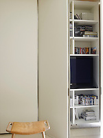 The television and DVD's are stored out of view in floor-to-ceiling cupboards