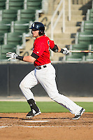 Trey Michalczewski (27) of the Kannapolis Intimidators follows through on his swing against the Augusta GreenJackets at CMC-NorthEast Stadium on August 3, 2014 in Kannapolis, North Carolina.  The Intimidators defeated the GreenJackets 10-5. (Brian Westerholt/Four Seam Images)