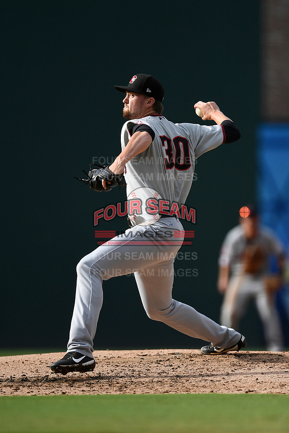 Pitcher Derek Heffel (30) of the Hickory Crawdads pitches into the sun in Game 1 of a doubleheader against the Greenville Drive on Wednesday, July 25, 2018, at Fluor Field at the West End in Greenville, South Carolina. Greenville won, 4-1. (Tom Priddy/Four Seam Images)