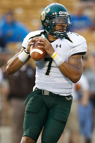 South Florida quarterback B.J. Daniels (#7) looks to pass the ball in action during NCAA football game between Notre Dame and South Florida.  The South Florida Bulls defeated the Notre Dame Fighting Irish 23-20 in game at Notre Dame Stadium in South Bend, Indiana.