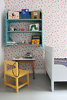 Iris's daughter's bedroom is also a mixture of vintage and design, tied together with a cheerful floral wallpaper