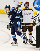 Matt Mangene (Maine - 57), Wade Bergman (Duluth - 28) - The University of Minnesota Duluth Bulldogs defeated the University of Maine Black Bears 5-2 in their NCAA Northeast semifinal on Saturday, March 24, 2012, at the DCU Center in Worcester, Massachusetts.