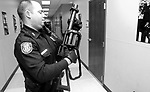 "Memphis Police Officer Lt. Terry Lyons with the Crisis Intervention Team prepares his SL6 Six Shot Semi-automatic Projectile Launcher. After you get passed the intimidation factor of it, the gun actually shoots rubber bullets, about the size of a baby's fist. ""We use these for mentally challenged individuals so we wont have to shoot them, just subdue them"" Lyons said."