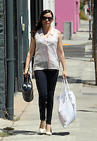 Rose McGowan went shopping on Melrose carrying her Louis Vuitton Epi Soufflot bag. She wore a side pig tail with cigarette cut denims, pointy [pumps and a sleevless pale pink striped blouse. Los Angeles, California on 19.08.2012..Credit: Correa/face to face.. /MediaPunch Inc. ***FOR USA ONLY*** ***Online Only for USA Weekly Print Magazines***