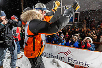 Pete Kaiser waves and shakes hands with the crowd at the Nome finish line after winning the 2019 Iditarod Trail Sled Dog Race. Pete's winning time is 9 days 12 hours 39 minutes and 6 seconds<br /> <br /> Photo by Jeff Schultz/  (C) 2019  ALL RIGHTS RESERVED