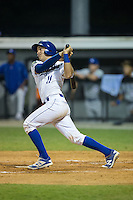 Michael Arroyo (11) of the Burlington Royals follows through on his swing against the Bluefield Blue Jays at Burlington Athletic Stadium on June 27, 2016 in Burlington, North Carolina.  The Royals defeated the Blue Jays 9-4.  (Brian Westerholt/Four Seam Images)