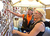 NWA Democrat-Gazette/BEN GOFF @NWABENGOFF<br /> Rusty Shaver and Carla Sanders of Dora, Mo. check out patches in a vendor's booth on Saturday Sept. 26, 2015 during the annual Bikes, Blues & BBQ motorcycle rally in downtown Fayetteville.