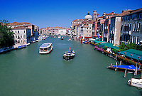The view of the ferries on the canal in Venice, Italy. boat, boats, transportation, cityscape, waterways. Venice, Italy.