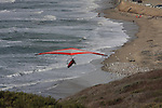 Hang glider at Waddell Beach in January