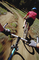 Tony Neaves (MR588) mountain biking (blurred action), Summit County, CO. Tony Neaves (MR588). Summit County, Colorado.