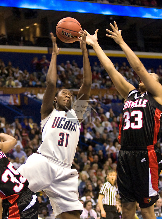 040709TVWOMENFINALFOUR17.UConn's Tina Charles (31, left) goes up for a rebond in the second half against Louisville's Monique Reid (33, right).  Charles was the MVP of the NCAA Women's Final Four Championship Tournament played at the Scottrade Center in St. Louis, MO on Tuesday April 7, 2009..MCT/TIM VIZER