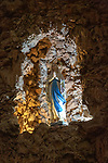 Statue of Blessed Virgin Mary standing in rock grotto ichurch of Igreja de Santiago, Tavira, Algarve, Portugal, Southern Europe