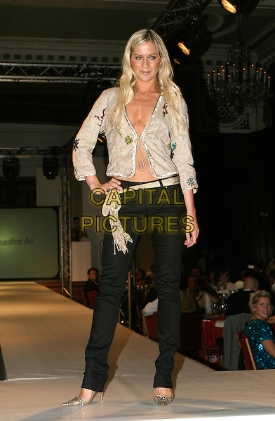 KATE LAWLER.SPARKS Fashion Show, Porchester Hall, London..October 6th, 2005.full length catwalk black trousers beige top hand on hip skin .www.capitalpictures.com.sales@capitalpictures.com.© Capital Pictures.