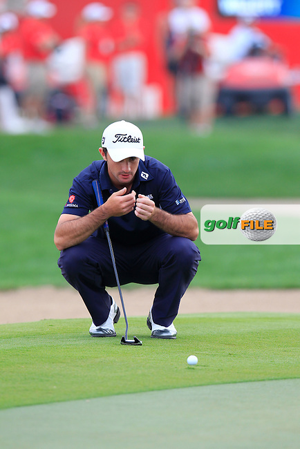 Gary Stal (FRA) lines up his putt on the 18th green during Sunday's Final Round of the Abu Dhabi HSBC Golf Championship 2015 held at the Abu Dhabi Golf Course, United Arab Emirates. 18th January 2015.<br /> Picture: Eoin Clarke www.golffile.ie