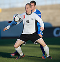 City's Andy Howat holds off Queen of the South's Stephen McKenna ...