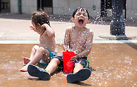 NWA Democrat-Gazette/CHARLIE KAIJO Kamala Agnew, 2 and Rohan Agnew, 4, of Bentonville, play Sunday, May 13, 2018 at the Lawrence Plaza splash pad in Bentonville. <br />