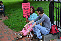 Washington, DC - August 12, 2018: A man and woman chat as protesters rally in Lafayette Park near the White House in Washington, D.C. to oppose the Unite the Right rally August 12, 2018.  (Photo by Don Baxter/Media Images International)