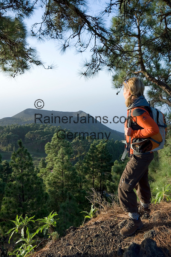 Spain, Canary Islands, La Palma, view at vulcano San Antonio near village Los Canarios Fuencaliente, woman with backpack hiking