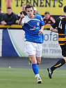Grant Gallagher celebrates after he scores Stranraer's goal.