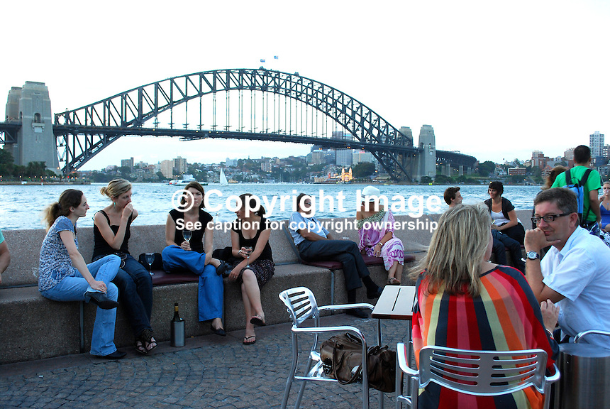 The environs of Sydney Opera House is a popular meeting place for a drink with friends & relaxation especially in the early evening when it is still warm enough to be in short sleeves. 201003284940..Copyright Image from Victor Patterson, 54 Dorchester Park, Belfast, United Kingdom, UK. Tel: +44 28 90661296. Email: victorpatterson@me.com; Back-up: victorpatterson@gmail.com..For my Terms and Conditions of Use go to www.victorpatterson.com and click on the appropriate tab.