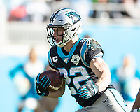 CHARLOTTE, NC - DECEMBER 15: Christian McCaffrey #22 of the Carolina Panthers runs with the ball during a game between Seattle Seahawks and Carolina Panthers at Bank of America Stadium on December 15, 2019 in Charlotte, North Carolina.