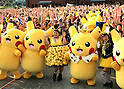 """August 12, 2016, Yokohama, Japan - Japanese actress and comedienne Naomi Watabe (C) smiles with Pikachu characters, Nintendo's videogame software Pokemon's wellknown character, after she and Pikachu performed dancing at a show """"Super Soaking Splash Show"""" in Yokohama, suburban Tokyo on Friday, August 12, 2016. The Pikachu mascots perfom the several shows daily to attract summer vacationers as a part of the """"Great Pikachu Outbreak"""" event through August 14.    (Photo by Yoshio Tsunoda/AFLO) LWX -ytd-"""