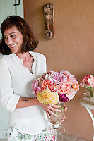 Maddalena Caruso holding a bunch of freshly cut roses