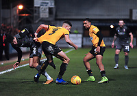 Lincoln City's Kellan Gordon vies for possession with Cambridge United's Jake Carroll, left, and Reggie Lambe<br /> <br /> Photographer Andrew Vaughan/CameraSport<br /> <br /> The EFL Sky Bet League Two - Cambridge United v Lincoln City - Saturday 29th December 2018  - Abbey Stadium - Cambridge<br /> <br /> World Copyright © 2018 CameraSport. All rights reserved. 43 Linden Ave. Countesthorpe. Leicester. England. LE8 5PG - Tel: +44 (0) 116 277 4147 - admin@camerasport.com - www.camerasport.com
