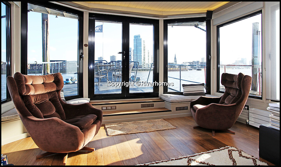 BNPS.co.uk (01202 558833)<br /> Pic: Riverhomes/BNPS<br /> <br /> Heart of Lightness - Tardis like houseboat on the Thames.<br /> <br /> A houseboat that looks more like a luxurious penthouse suite inside has gone on the market for a whopping &pound;1.5 million - because it's in one of London's most exclusive locations.<br /> <br /> The 100ft vessel was once a former Dutch barge taking supplies up and down the Thames until it was retired from service in the 1960s and left to rot.<br /> <br /> But a decade later it was salvaged and turned into a houseboat before undergoing a complete refurbishment four years ago and moved to a premier mooring alongside one the swankiest addresses in the city.<br /> <br /> The plush houseboat, berthed at the entrance to Cheyne Walk, now boasts a lavish living room, stylish 50ft-long kitchen, a spiral staircase, two opulent bedrooms, three bathrooms and even a sun terrace.<br /> <br /> And despite its eye-watering &pound;1.5m asking price, experts at Riverhomes estate agents say the houseboat is actually a bargain and that anyone wanting to live in such luxury in the heart of Chelsea would have to shell out many millions more.