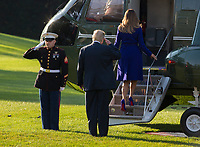 United States President Donald J. Trump salutes the Marine Guard as he and First Lady Melania Trump depart the White House in Washington, DC, November 3, 2017 for a multi-day trip to Hawaii and then on to Asia. <br /> Credit: Chris Kleponis / CNP /MediaPunch