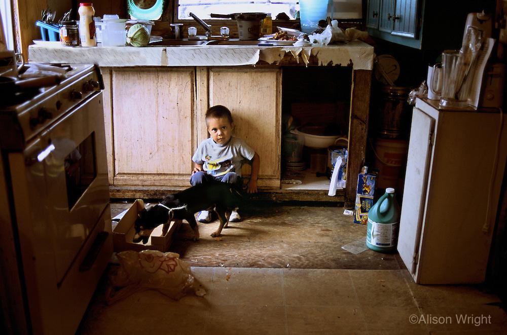 Texas, Rio Grande Valley. Boy in his home.